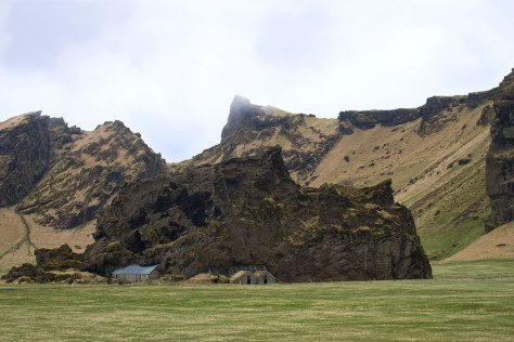 Rock growing over house, Iceland 2012