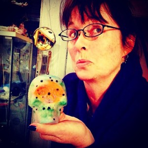 Author, Jill Edmondson poses A la Hamlet with her glass sugar skull